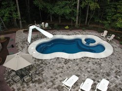 <div class='closebutton' onclick='return hs.close(this)' title='Close'></div><div class='firstH'><img src='images/logo-white-small.png'></div><h1>Free Form Fiberglass Pool</h1><p>Free Form - Laguna Deluxe Fiberglass Pool #002 by Aquarius Pools Construction Co. Inc.</p><div class='getSocial'><h1>Share</h1><p class='photoBy'>Photo by Aquarius Pools Construction Co. Inc.</p><iframe src='http://www.facebook.com/plugins/like.php?href=http%3A%2F%2Faquariuspool.net%2Fimages%2Ffiberglass%2FFree Form%2Flaguna-deluxe%2F002.jpg&send=false&layout=button_count&width=100&show_faces=false&action=like&colorscheme=light&font&height=21' scrolling='no' frameborder='0' style='border:none; overflow:hidden; width:100px; height:21px;' allowTransparency='true'></iframe><br><a href='http://pinterest.com/pin/create/button/?url=http%3A%2F%2Fwww.aquariuspool.net&media=http%3A%2F%2Fwww.aquariuspool.net%2Fimages%2Ffiberglass%2FFree Form%2Flaguna-deluxe%2F002.jpg&description=Pools' data-pin-do='buttonPin' data-pin-config=\'above\'><img src='http://assets.pinterest.com/images/pidgets/pin_it_button.png' /></a><br></div>